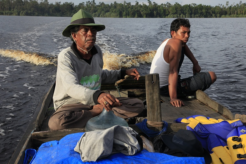 Pak Dani Jambang and his son Nasir are on their way back from fishing to the village of Teluk Meranti. Twice a week they do the make the ten hour journey to catch fish they later sell at the village market. Their catch has declined dramatically during the last twelve years as the surrounding deforestation impacts the local environment.
