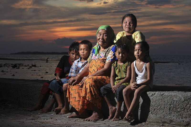 Samiah, 86, with her family from Pulau Pramukha. Most families here are concious of a change in weather patterns and sea tides but are not familiar with anthropogenic climate change and its potential affect on their lives.