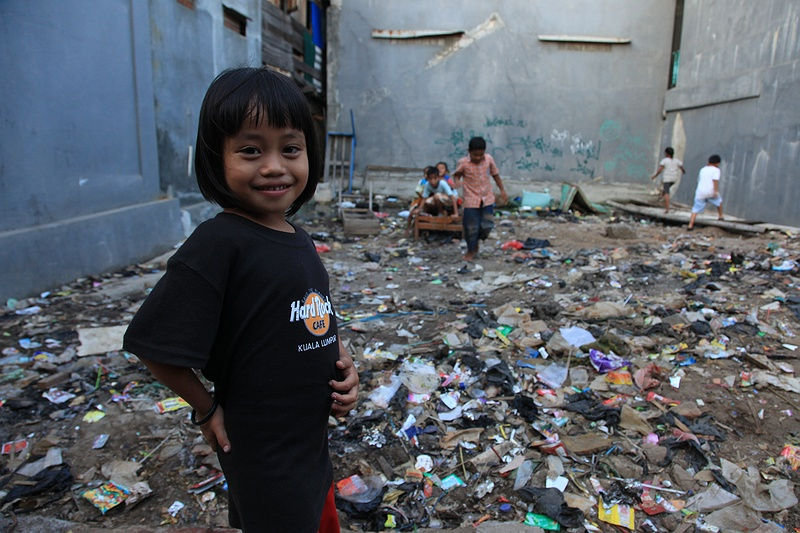 Children play in rubbish outside there home in a slum in north Jakarta. The UN Human Settlements Program estimates that 26 percent of Indonesia's urban population live in slums. Greater Jakarta housing some 5 million alone.