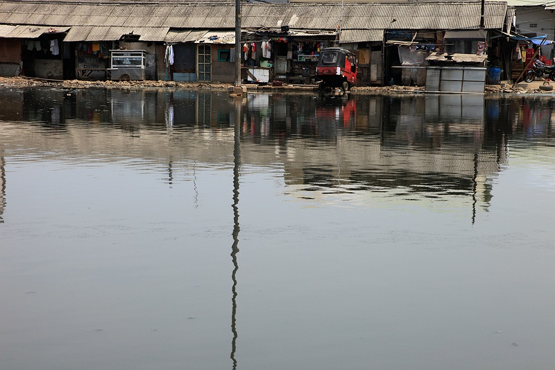 Floods and extreme weather are becoming more common in Jakarta. Designed to cope with  floods originally by Dutch colonists, the intricate web of canals should divert the excess water toward the sea, but poor maintenance leaves them clogged with rubbish and waste discarded by the city.