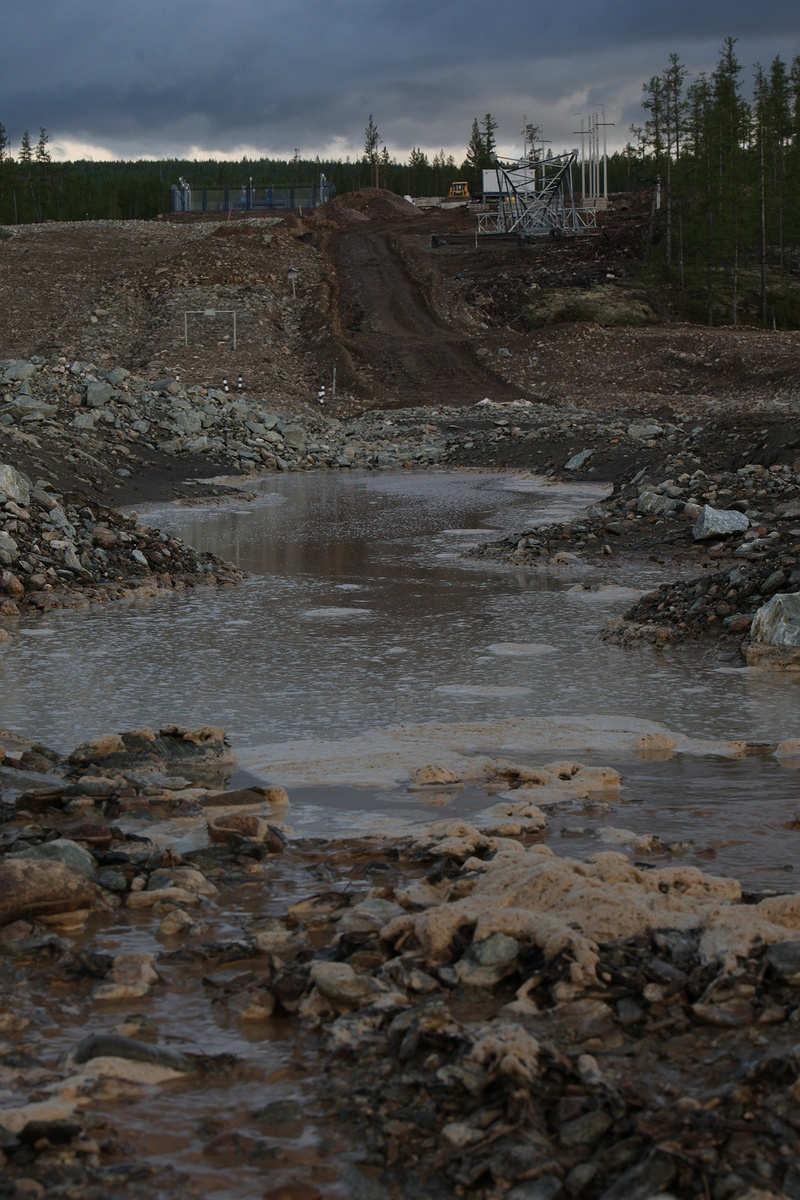 Muddy melt water from the construction site of the oil pipe line outside Iengra. When finished it will be 4,700 kilometres long, stretching from Siberia to China exporting over 300,000 barrels of oil a day.
