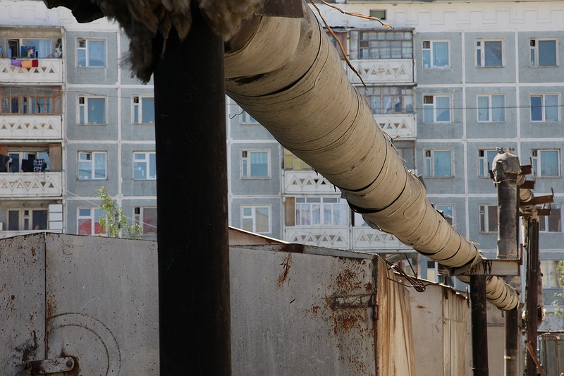 Pipelines is constructed above ground in Yakutsk. Building on permafrost is difficult due to the heat of the building or pipeline is thawing the permafrost and therefore sinking. This in combination with warmer climate has caused a lot of infrastructure problems in permafrost regions.