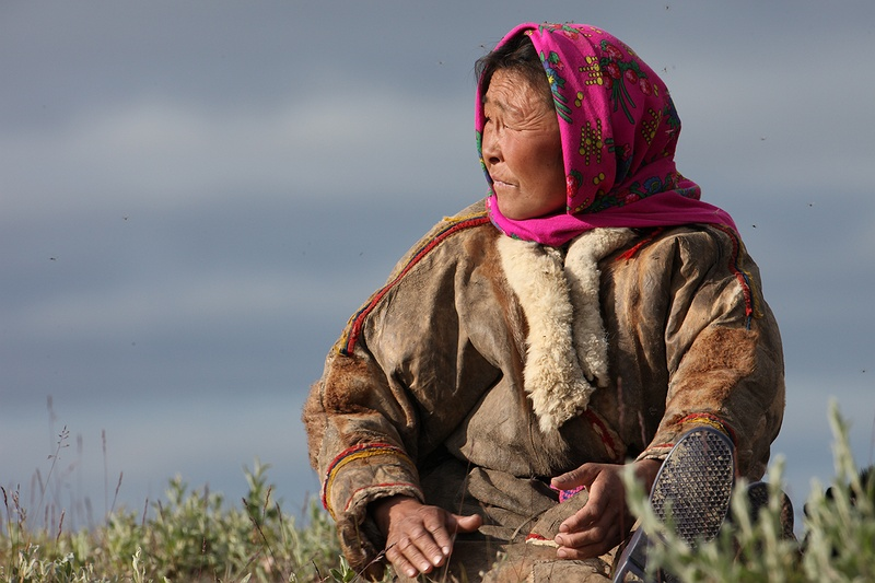 A woman waits for the rest of the tribe and reindeer to cross the Yuribey river. The tribe manage over 2,000 state reindeer and the migration over the river is only possible at certain points of the year. Today more than 10,000 nomads herd about 300,000 domestic reindeer on the Arctic tundra.