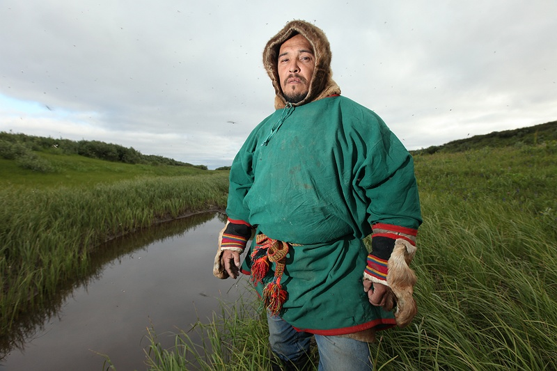 Kirill Serotetto, our Nenets guide from the town of Yar-Sale stands next to a thermokarst lake near his tribes settlement. Thermokarst lakes are formed as ice-rich permafrost thaws and collapses leaving a pool of melt water. In 2007 Kirill and his brother famously found a 6 month old baby mammoth preserved for 10,000 years and exposed by thawing ice layers along the Yuribey river.