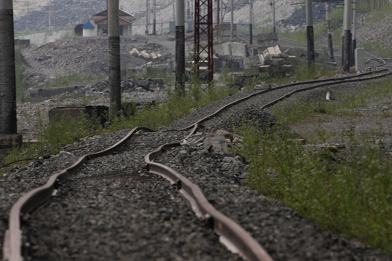 Railways built on permafrost has settled unevenly as the ground melts, resulting in a 'roller coaster' buckling effect. The ballast supporting the sleepers in some parts of the line has also collapsed leaving bent rails suspended in mid air. The Russian rail network is one of the biggest in the world with its 85,000 kilometres of track. The tracks where predominantly built in the Soviet era from the 1920s to 1991 before being inherited by the Russian Federation.