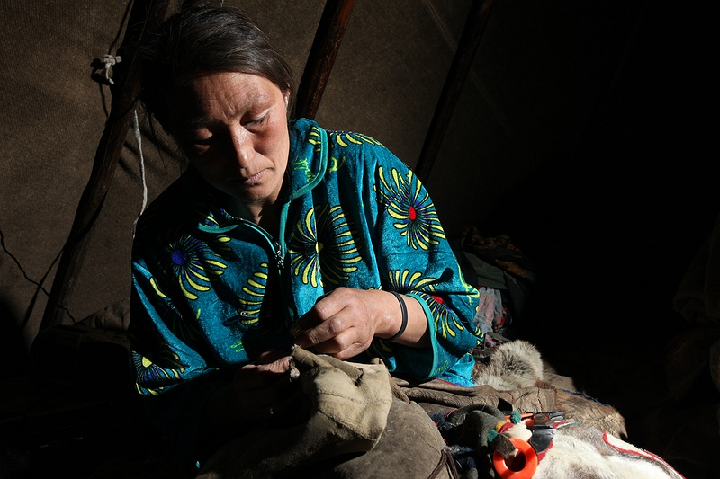 Valya sews her husband Yasha a new pair of boots made completely from reindeer.  She uses the deer sinew as thread to pull in the layers of fur tightly.  Almost all clothes the Nenet use and make are from reindeer skin.