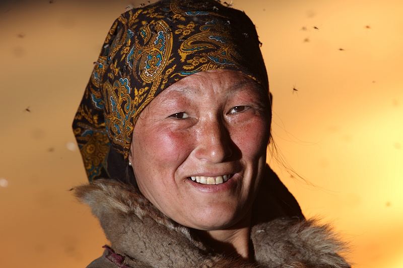 Valya is part of the nomadic Nenets tribes living all year round on the tundra of the Yamal Peninsula. In the Nenet family model it falls on the youngest son to look after the parents when they are old and subsequently inherit the family home called a chum. However both Valya and her husband [photolink 578 Yasha] don't expect their traditional way of life to last longer than forty years. As the [tag permafrost permafrost] [photolink 316 thaws] the landscape she knows is dramatically changing. Western scientists are now increasingly concerned that if the global temperature continues to rise, millions of tonnes of methane locked in the [tag permafrost permafrost] will be released into the atmosphere accelerating climate change and mirroring the fate of the Nenets onto the rest of the world.