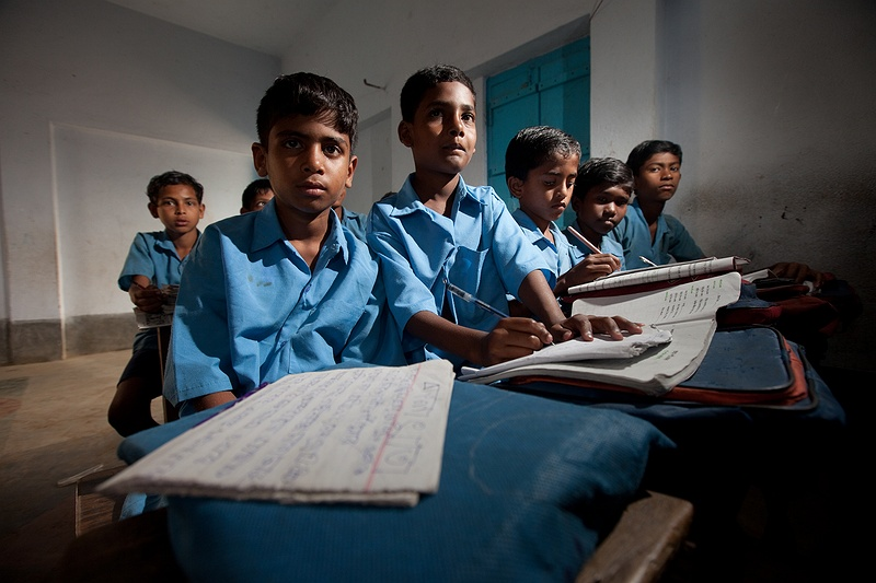 Students studying in Sreedham Gangasagar school. Many children on Sagar Island don't get the opportunity to continue their studies after fifth grade. 60 percent of the families don't own any land and cant afford to pay the small cost for their children's books.