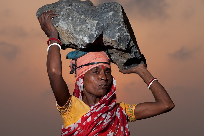 Minu Sau balances a huge rock for the base layer of the Sagar Island sea defence wall on her head. Despite long and extremely hard working days the atmosphere is positive among the community. All in the community know the importance of the wall, they all share the hope that it will keep them safe from the impacts of climate change. The previous 2 kilometre long wall was destroyed by cyclone Aila. Hundreds of people were killed and more than 22,000 homes were ravaged when cyclone Aila struck the Bay of Bengal in May 2009.