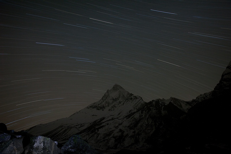 "Star trails above Shivling peak viewed from Tapovan meadow above the Gaumukh glacier, source of the river Ganges. This peak rises 6,543 meters above sea level and is said to resemble Lord Shiva. Some people say a glimmering ""eye"" can be seen on the peak certain days."