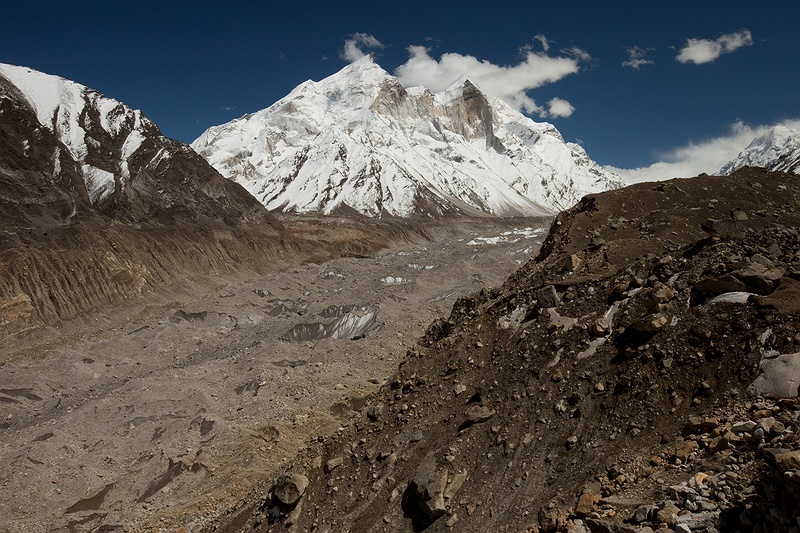 The Bhagarathi peaks tower above the Gangotri glacier. The ice sheet is today is a little less than 30 kilometres long. Data from 1936–96 show total recession of the Gangotri glacier to be 1147 m, with the average rate of 19 m per year. According to NASA the glacier retreated more than 850 metres during the last 25 years of the 20th century, with an average rate of 34 metres per year.