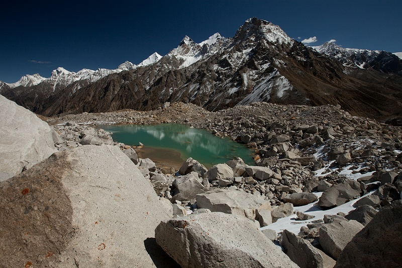 A lake created from snow and ice melt just above Gaumukh, the mouth of the Gangotri glacier. If the water can't flow out and melting continues, this could cause unpredicted devastation further down the valley in  Bhojbasa when the lake bursts. This phenomenon is called Glacial Lake Outburst.