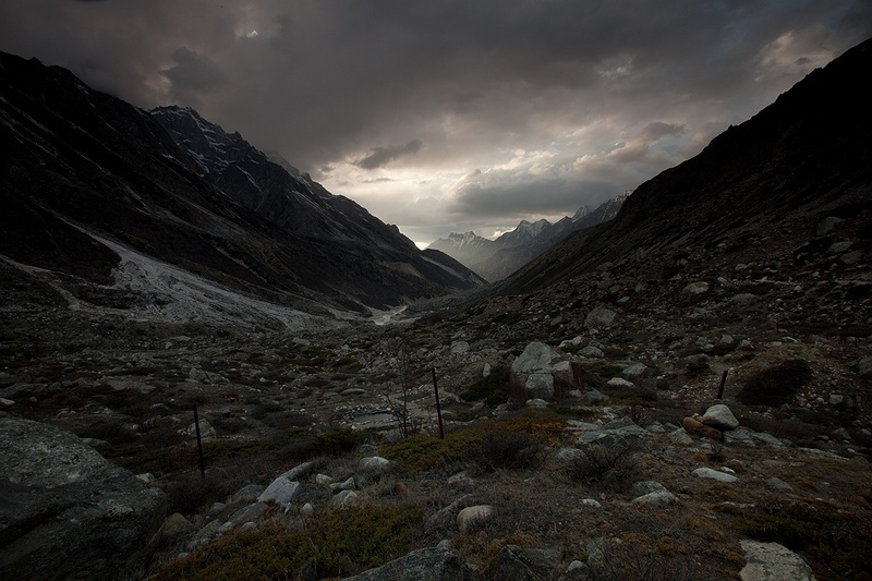 The clouds come in quickly over the valley on the way from Gangotri glacier towards Bhojpasa. The Himalayas play a significant role in the dynamics of the Indian monsoon. Radiation balance due to snow and ice cover provides feedback mechanisms for advection water vapour from the surrounding oceans needed for the maintenance of seasonal cycles such as the monsoon.