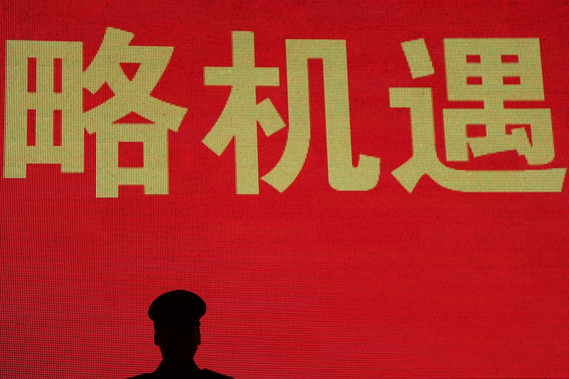 The silhouette of a Chinese police officer in Tienanmen square during the 60th anniversary of communist China celebrations.