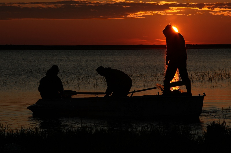 Three men fishing on the Ob River late evening outside Yarsale. Fresh fish is a staple diet for all communities [photolink 435 nomadic] or town based in this part of Russia.