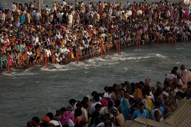Pilgrims take a holy dip in the Ganges in Haridwar during the 2010 Kumbh Mela festival. The Police reported drowning fatalities as pilgrims unable to swim were swept away by the fast flowing river. 16 million pilgrims visited the 2010 festival making it the world's largest religious gathering. The water begins it's flow from around 18,000 glaciers that store a massive 12,000 square kilometres of freshwater. Together with snow-melt they contribute to the summer flow of Ganges and other major life giving rivers such as the Indus, Brahmaputra, Yangtze and Yellow Rivers.