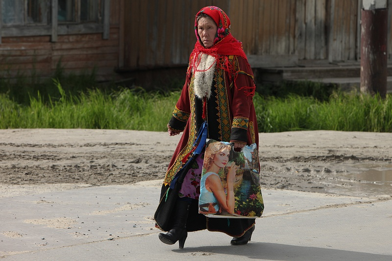 A woman in Yar-Sale dressed in traditional Nenets clothing. The town is the last outpost before the extensive tundra of the Yamal Peninsula and many Nenets families living as nomads [photolink 421 hope] for an apartment here. As they notice the landscape changing and the increasing dominance of Gazprom they fear for their future. Waiting lists are long and the transition from sustainable nomadic life to industrial town are understandably difficult.