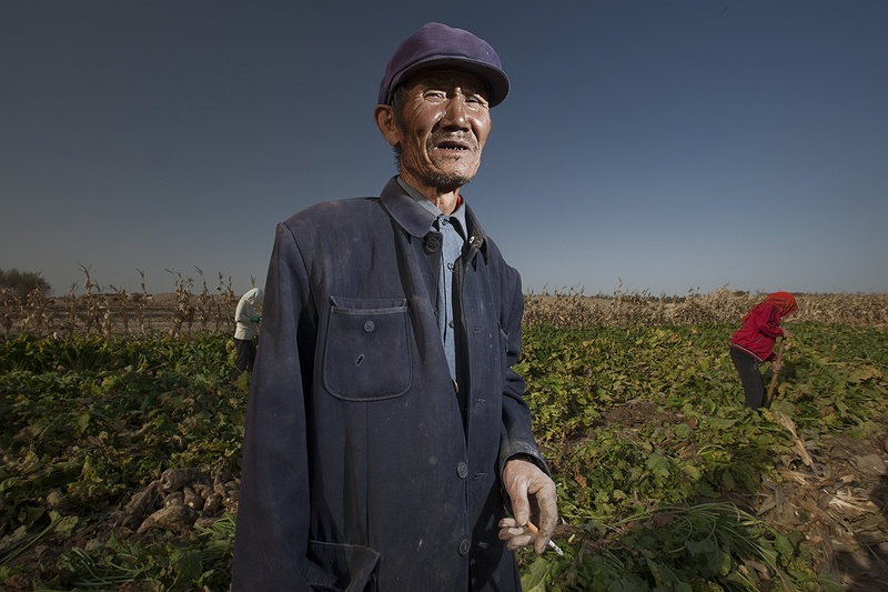 Mr Zhang, 72, explains the problem with limited water,